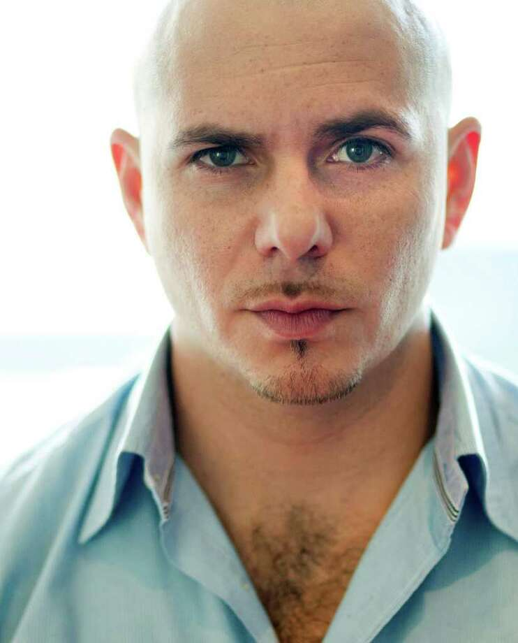 """Rapper Pitbull poses for a portrait in Los Angeles, Wednesday, June 22, 2011. Pitbull's new album """"Planet Pit"""" was released on Tuesday. Photo: AP Photo/Matt Sayles"""