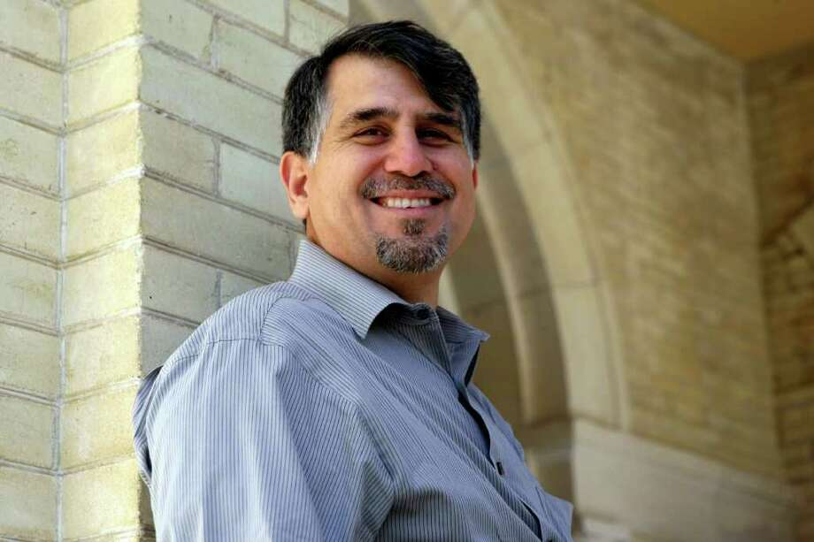 OLLU professor of psychology Ezequiel Pena recently won a research grant to determine what type of training best prepares bilingual counselors to treat the underserved Spanish-speaking community. He was one of 13 professors in Texas to receive the grant. His goal is to develop training guides for Spanish-language mental health professionals because none currently exist. Photo: HELEN L. MONTOYA, HELEN L. MONTOYA/hmontoya@conexionsa.com / SAN ANTONIO EXPRESS-NEWS