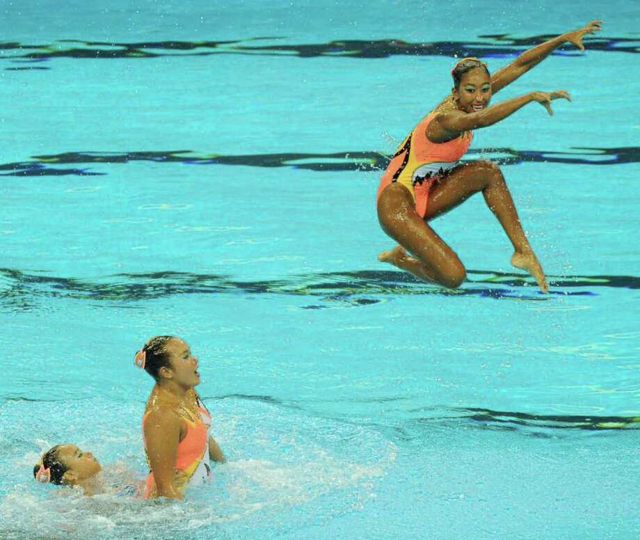 Singapore's synchronized swimming team competes in the preliminary round of the free combination synchronized  swimming competition in the FINA World Championships at the indoor stadium of the Oriental Sports Centre in Shanghai. Photo: MARK RALSTON, AFP/Getty Images / 2011 AFP
