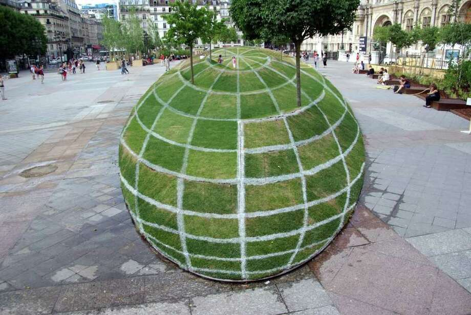 This garden installation in front of Paris City Hall is not what it seems. Click through the gallery to see the secrets behind this optical illusion, created by artist François Abelanet. (Photo: Paris Daily Photo) Photo: Eric Tenin/ParisDailyPhoto.com