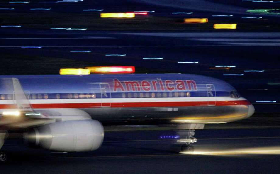 An American Airlines jet taxis on a runway as it takes off at Logan International Airport in Boston Tuesday, July 19, 2011. American's parent, AMR Corp., said Wednesday, July 20, it will buy 260 planes from Airbus and 200 from Boeing. It will also take options and purchase rights for up to 465 additional planes through 2025.  (AP Photo/Elise Amendola) Photo: Elise Amendola