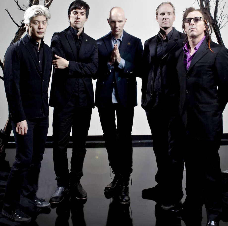 Alt-metal band A Perfect Circle -- (from left) James Iha, Matt McJunkins, Billy Holwerdel, Josh Freese and Maynard James Keenan -- plays a sold-out show at Freeman Coliseum Friday. COURTESY TIM CADIENTE