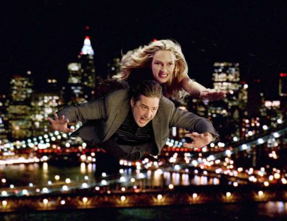 A single guy (Luke Wilson) learns a lesson about breaking up with superheroes (Uma Thurman), in  My Super Ex-Girlfriend. Photo: 20th Century Fox