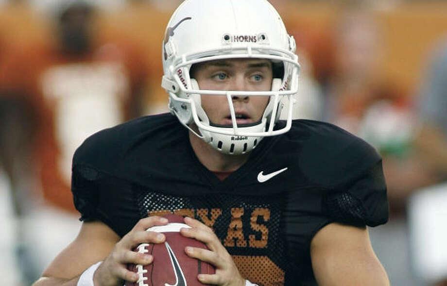 Texas quarterback Colt McCoy will start on Saturday. Photo: HARRY CABLUCK, AP