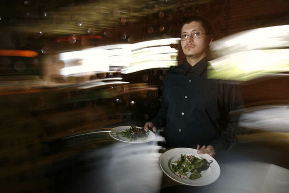 Überwaiter Alan Stevens is at your service at Monica Pope's t'afia. Photo: Kevin Fujii, Chronicle