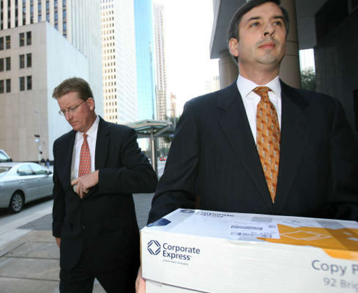 Mark Koenig, left, former Enron head of investor relations, leaves the federal courthouse in downtown Houston today with his attorney Philip Inglima after being sentenced.