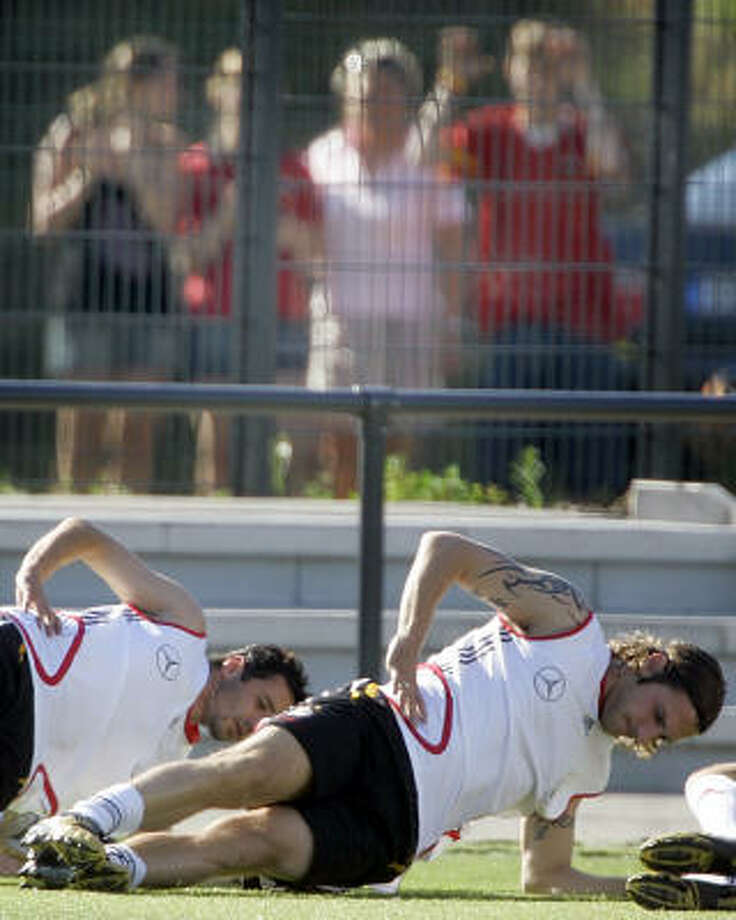 Germany soccer players Torsten Frings, right, and Oliver Neuville do side plank at practice during the World Cup. Photo: FRANK AUGSTEIN, Associated Press