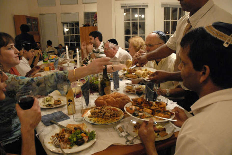 The Abraham, Farchy and Gadot families share Shabbat dinner every Friday and are celebrating the Jewish New Year together this year. Photo: Meenu Bhardwaj, For The Chronicle