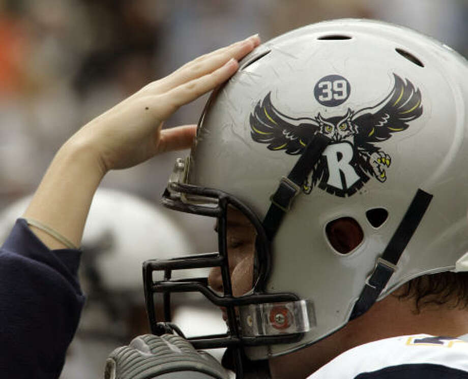 Owls honored Dale Lloyd's memory by adding No. 39 to their helmets. Rice beat Army one day before Lloyd's funeral. Photo: JIM MCKNIGHT, AP