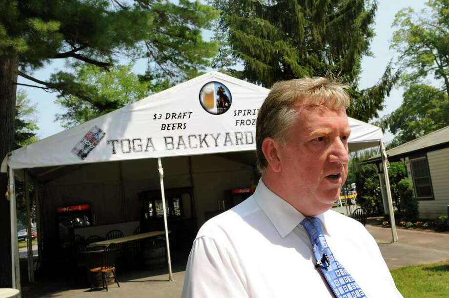 Stephen Travers, NYRA's director of hospitality and group sales, center, talks about lower beer prices this year while giving a tour for the media on Wednesday, July 20, 2011, at Saratoga Race Course in Saratoga Springs, N.Y. (Cindy Schultz / Times Union) Photo: Cindy Schultz