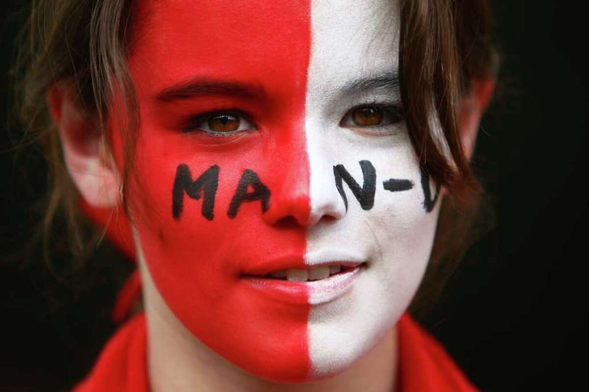 Manchester United fan Nellie Bourne, 15, sports face paint during an international friendly match between Manchester United and the Seattle Sounders at CenturyLink Field in Seattle on Wednesday, July 20, 2011.