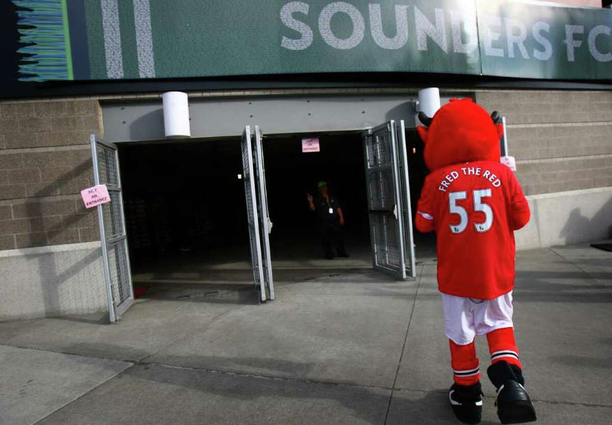 The Manchester United mascot walks into CenturyLink Field.