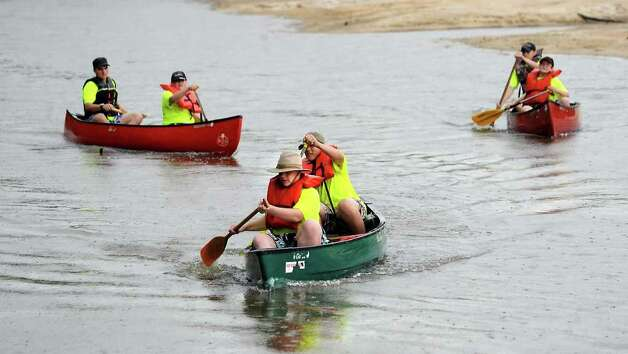 Boy Scouts navigate their canoes through the twists and turns during the Boy Scout Camp-O-Ree at Village Creek State Park. Tammy McKinley/ The Enterprise Photo: TAMMY MCKINLEY / Beaumont
