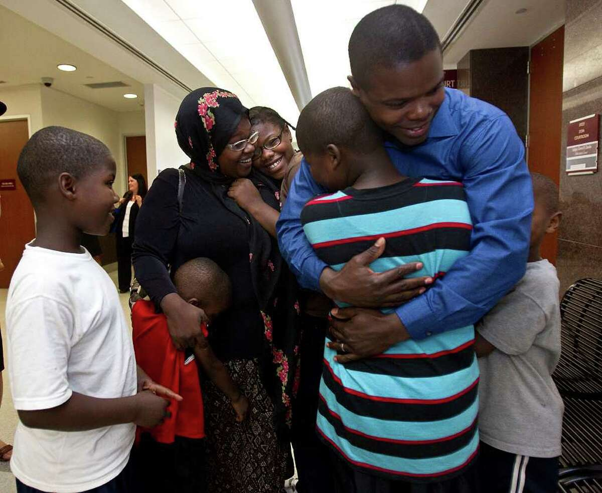 The Leonard family reunites for the first time in the hallways of the Juvenile Justice Harris County courthouse, Wednesday, July 20, 2011 in Houston, Texas. (l-r) Eight year-old Raheem Leonard, stands by with a smile as four year-old Abdullah Leonard hugs his mother Charlomane Leonard along with sister twelve year-old Sabrina Leonard, while ten year-old Prince Leonard II receives a hug from his father Prince Leonard, as seven year-old Saleem Leonard stands by. A Harris County juvenile judge ruled Wednesday July 20, 2011 that a Houston couple, whose six children were removed from their custody after caseworkers found the family living in a storage shed, will be able to have their children back. (Billy Smith II / Houston Chronicle)