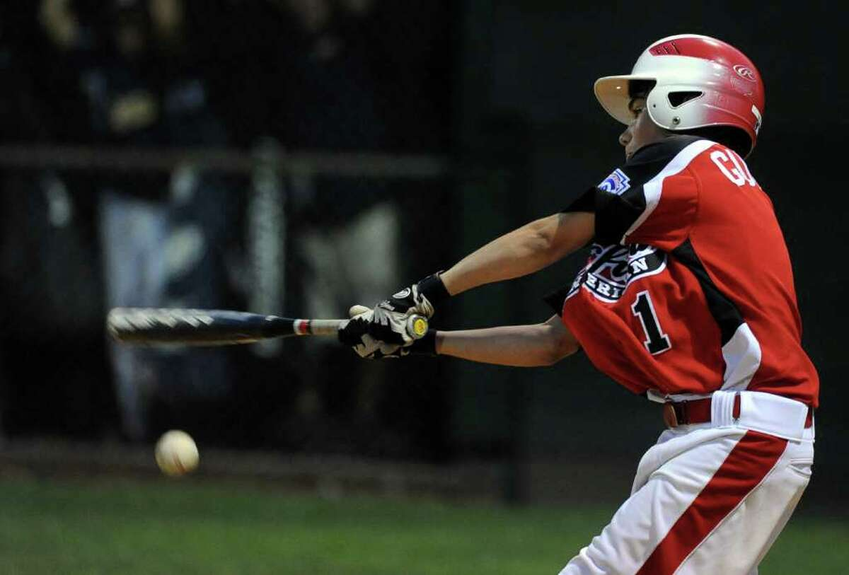 Fairfield American's Sean Gutierrez hits a foul ball during Wednesday's Little League sectional game in Orange on July 20, 2011.