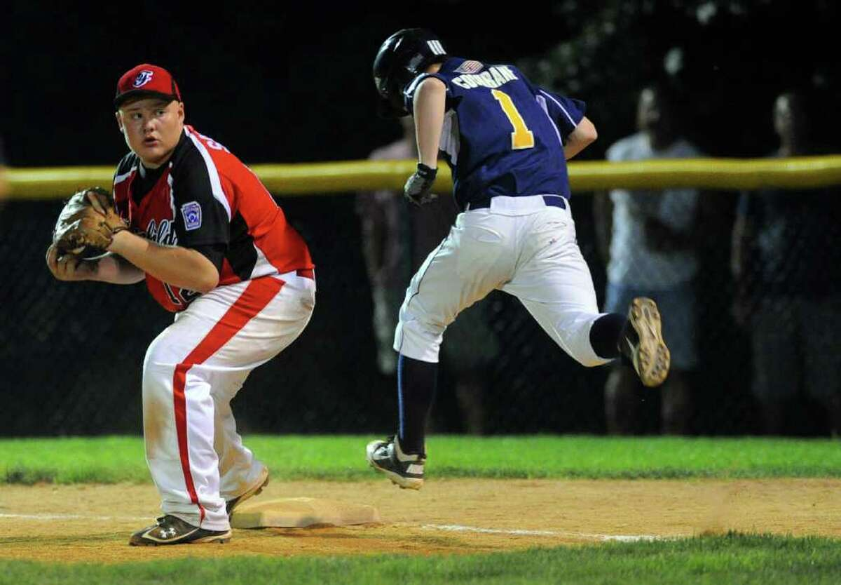 Fairfield American's Eddie Schwartz gets East Haven's Steve Cochrane out at first during Wednesday's Little League sectional game in Orange on July 20, 2011.