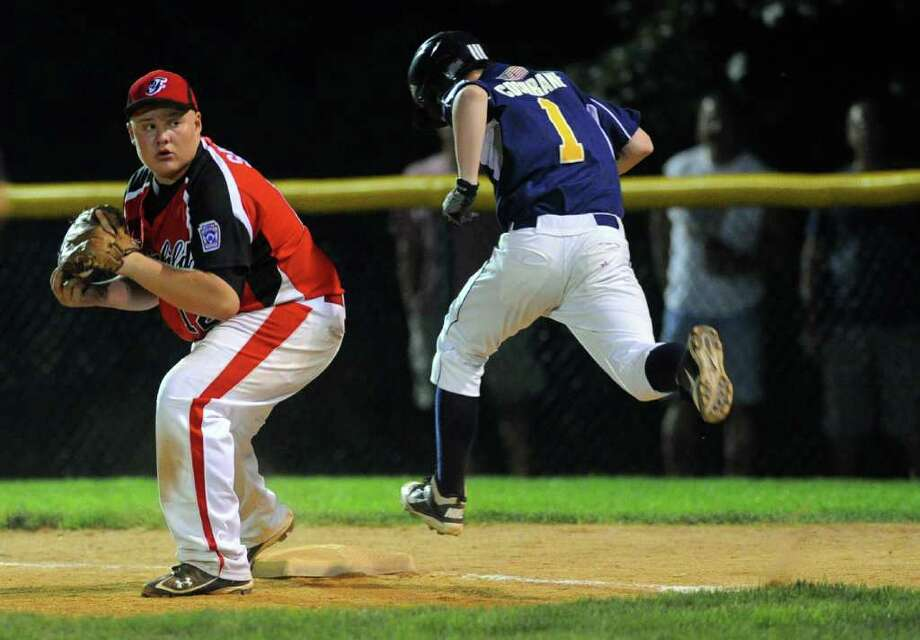 Fairfield American's Eddie Schwartz gets East Haven's Steve Cochrane out at first during Wednesday's Little League sectional game in Orange on July 20, 2011. Photo: Lindsay Niegelberg / Connecticut Post