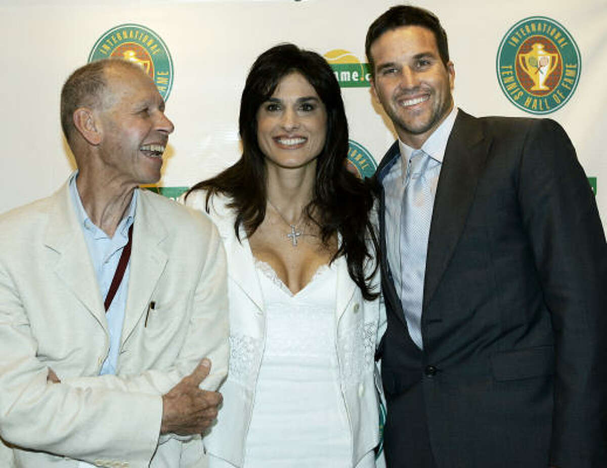 Tennis greats Gabriela Sabatini, center, of Argentina, and Patrick Rafter, right, of Australia, pose with Italian journalist Gianni Clerici prior to their inductions into the International Tennis Hall of Fame.