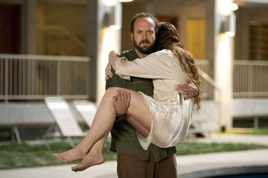 Paul Giamatti and Bryce Dallas Howard star in The Lady in the Water. Photo: Warner Bros.