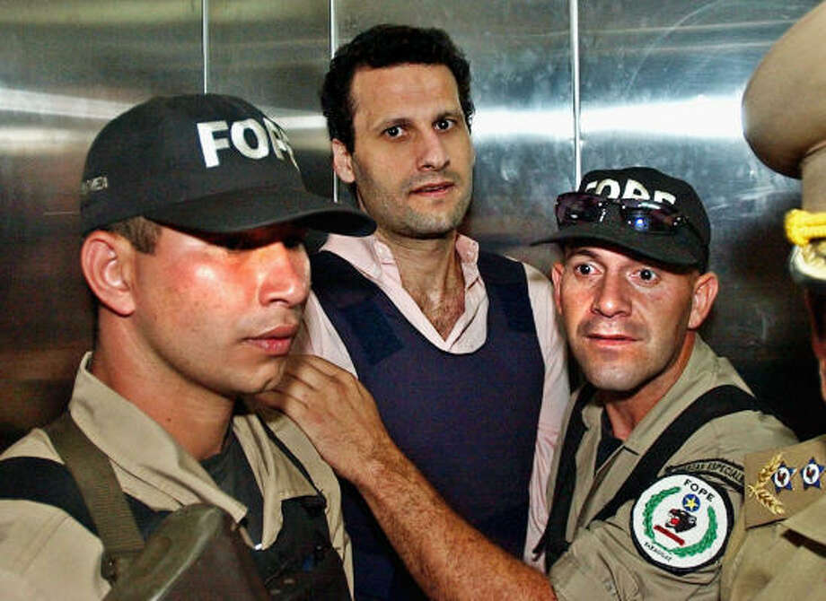 Lebanese citizen Assad Ahmad Barakat arrives handcuffed at a courthouse in November 2003 in Asuncion, Paraguay. The U.S. Treasury Department describes Barakat as a high-level Hezbollah financier. He is serving a 6 1/2 -year prison term in Paraguay. Photo: JORGE SAENZ, AP File