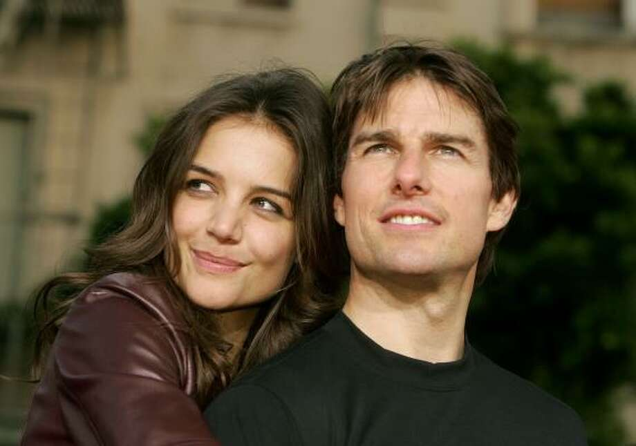 Tom Cruise and Katie Holmes arrive for a Los Angeles screening of War of the Worlds, June 27, 2005. Photo: Kevin Winter, Getty Images