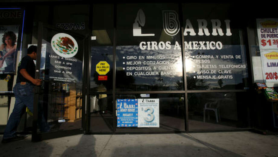 Remittances to Mexico from immigrants in Texas are expected to soar to $5.2 billion this year. Barri Giros a Mexico is a money-wiring agency in southwest Houston. Photo: Steve Ueckert, Chronicle