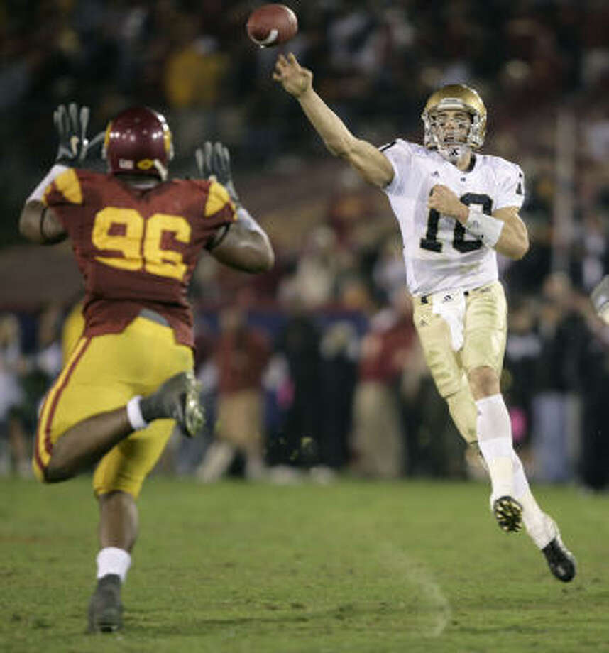 Just how would Brady Quinn (10) look in red, white and blue? Photo: MATT SAYLES, AP