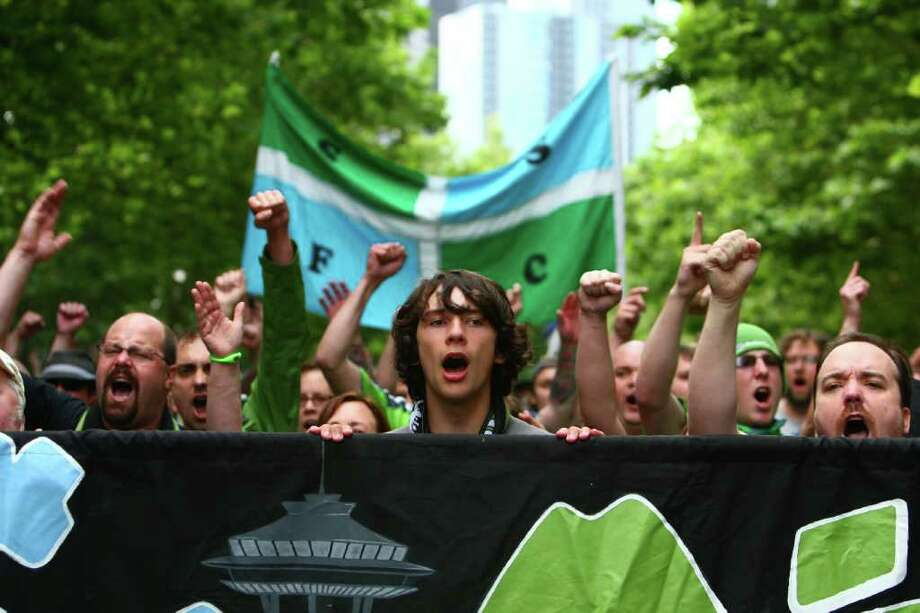 Members of the Emerald City Supporters march to the match. Photo: JOSHUA TRUJILLO / SEATTLEPI.COM