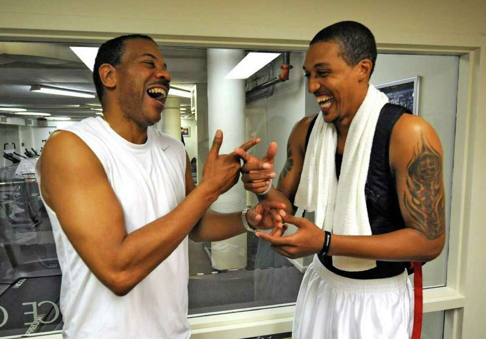 Former CBA player and now NBA standout Jamario Moon, right, made his way back to Albany, N.Y. July 20, 2011, to visit and workout with former team mate Derek Rowland at the Stueben Club. (Skip Dickstein/ Times Union)