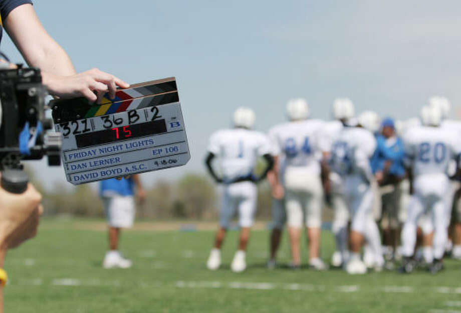 A camera assistant prepares for filming Friday Night Lights last month at a stadium in Del Valle. Executive producer Peter Berg says the show is equally concerned with what happens off the field. Photo: Chris Carson, For The Chronicle