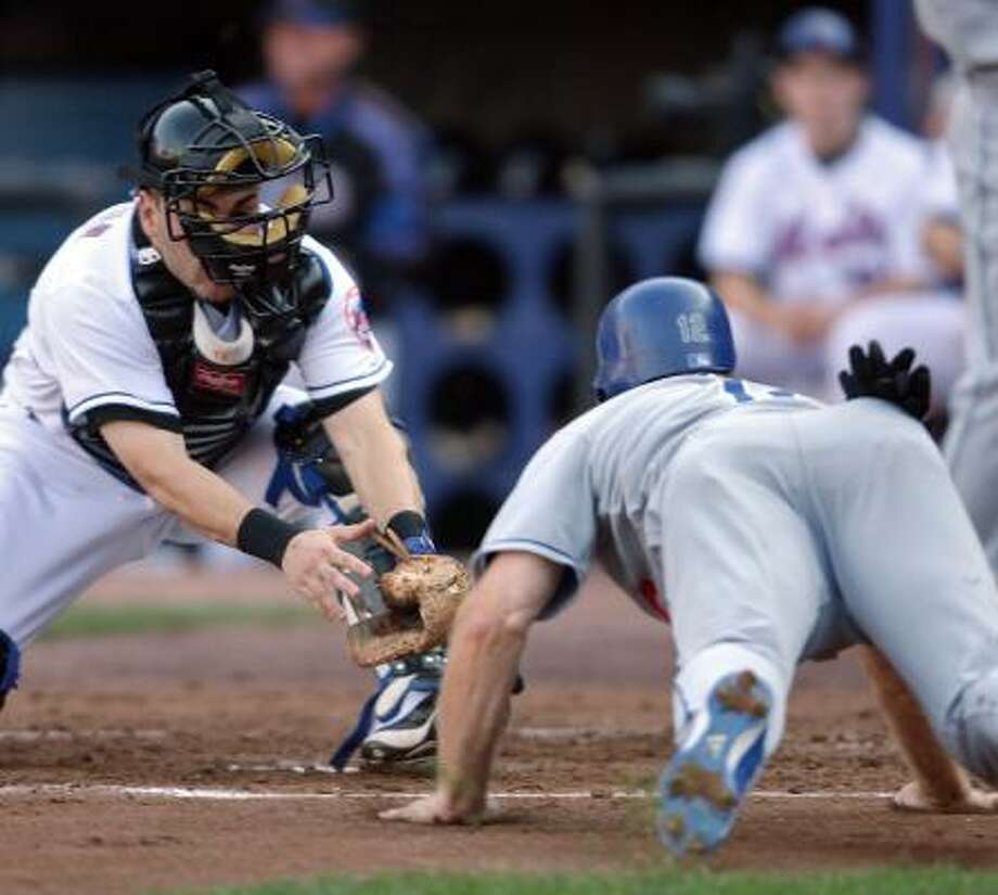 New York's Paul Lo Duca tags out Jeff Kent at home at Shea Stadium ... Photo: Travis Lindquist, Getty Images