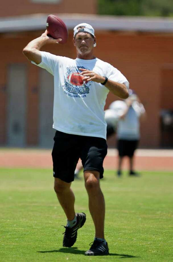 Former Dallas Cowboys Pro Bowl tight end Jay Novaceck works with kids at his football camp Wednesday, July 20, 2011 at Lopez Middle School.  The NFL's new collective bargaining agreement will reportedly improve benefits for retirees.  SALLY FINNERAN/sfinneran@express-news.net Photo: SALLY FINNERAN, Express-News / sfinneran@express-news.net