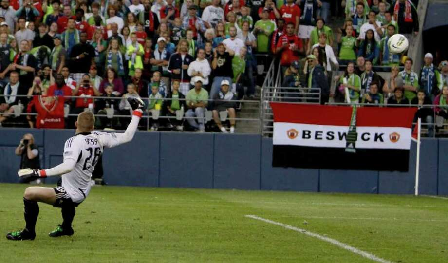 Ball blows past Terry Boss and into the goal. Photo: JOE DYER / SEATTLEPI.COM