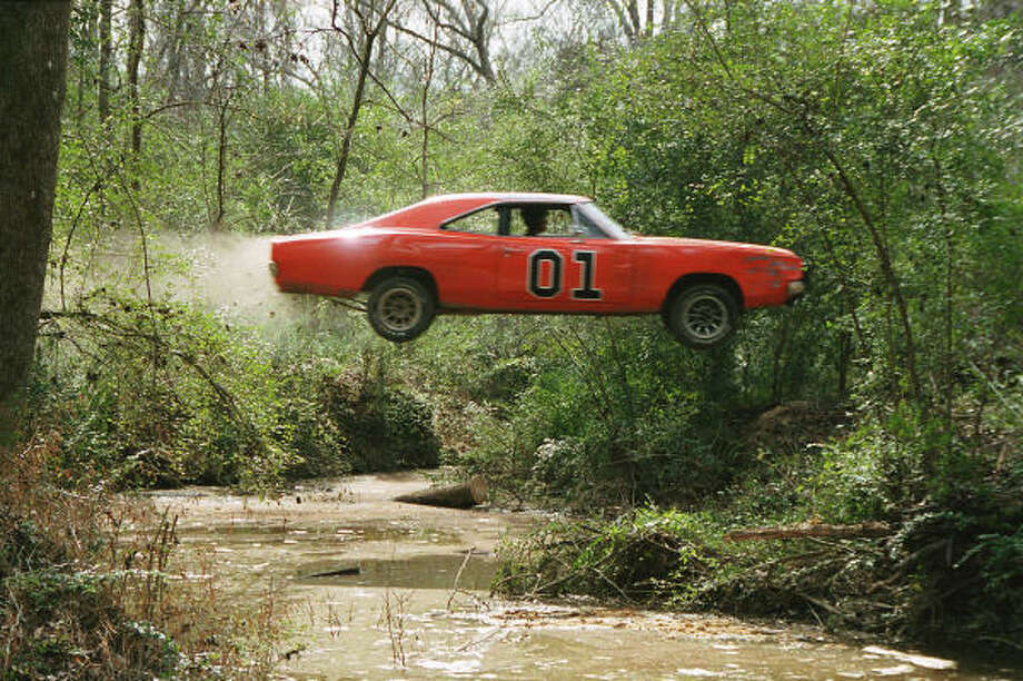 The General Lee sails over a stream in a scene from The Dukes of Hazzard. Photo: Van Redin, Warner Bros. Pictures