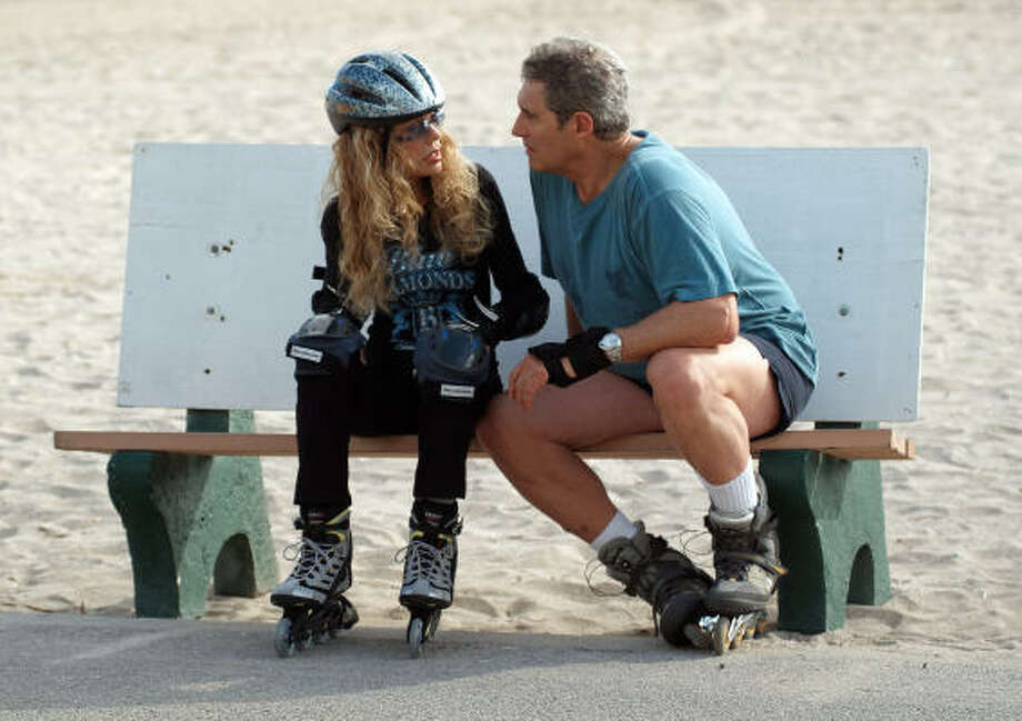 In Boynton Beach Club, a date between Lois (Dyan Cannon) and Daniel (Michael Nouri) includes some talking and some rollerblading. Photo: Samuel Goldwyn Films