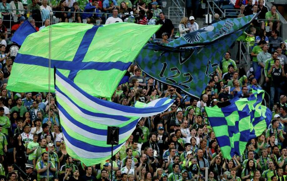 Sounders fans flying flags. Photo: JOE DYER / SEATTLEPI.COM
