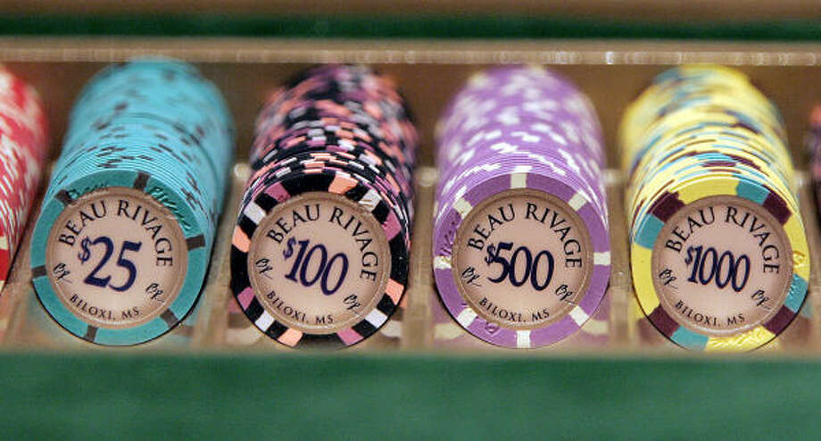 New Beau Rivage Resort and Casino chips are ready for players after the casino reopened Tuesday. The Beau Rivage, built in 1999, is the seventh casino on the coast to reopen after the storm. Photo: ROGELIO V. SOLIS, AP