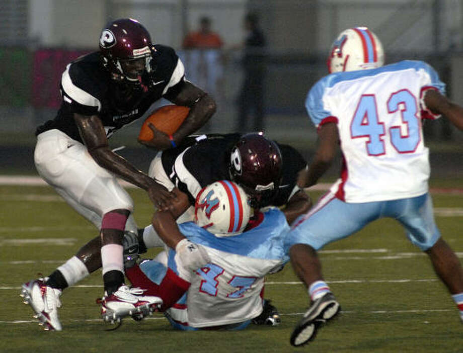 Pearland's Sam Proctor looks for room in action against Madison Sept. 8. Photo: Kim Christensen, For The Chronicle