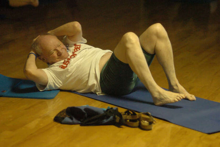 Everett Slavens of The Woodlands performs a pilates exercise during a recent class at the Shadowbend YMCA in The Woodlands. Photo: David Hopper, For The Chronicle