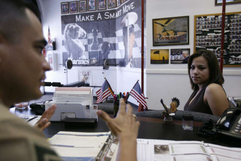 Delia Gutierrez, 18, an immigrant from San Luis Potosi state in Mexico, listens to a Marine recruiter in Brownsville. Photo: Mayra Beltran, Chronicle