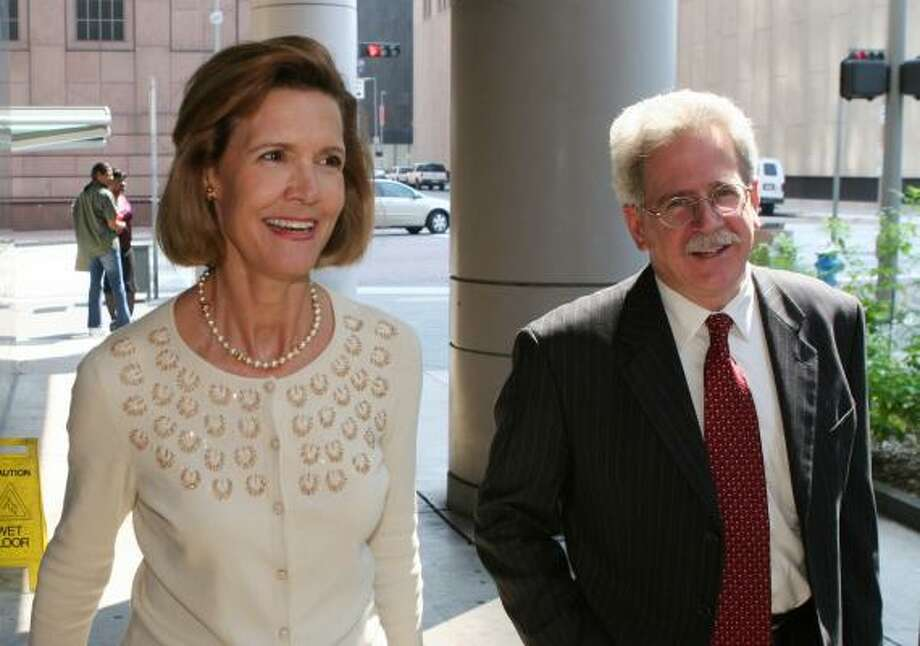 Former Enron investor relations executive Paula Rieker, left, arrives at Federal court in Houston with attorney Wes Loegering where she was sentenced to two years probation and a $50,000 fine on Friday. Rieker's testimony in the Enron trial helped convict Enron founder Ken Lay and former CEO Jeff Skilling for fraud in their trial earlier this year. Photo: RICHARD CARSON, REUTERS
