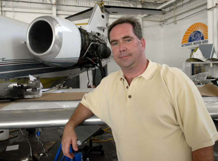 Rob Satterwhite in front of one of the planes his company is working on at Satterwhite Aviation Service Inc. at Ellington Field. Photo: Kim Christensen, For The Chronicle