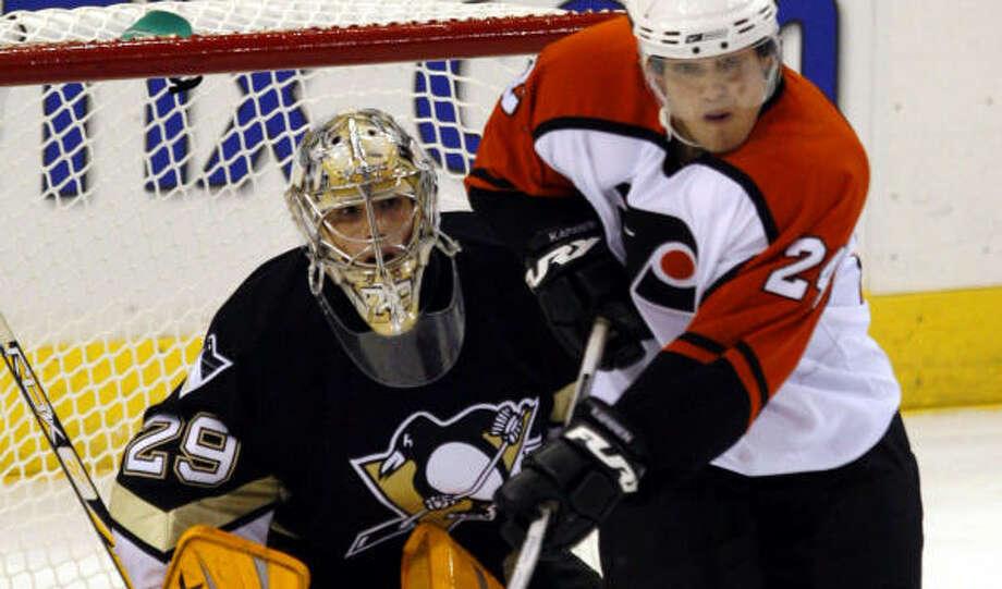 Penguins goalie Marc-Andre Fleury makes a save to preserve a 4-0 shutout against the Flyers. Photo: GENE J. PUSKAR, AP