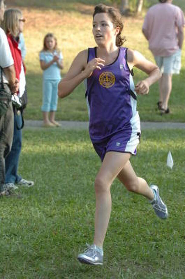 Kinkaid junior Ginny Simon has emerged as the Falcons' No. 1 runner this season. Photo: Thomas Nguyen, For The Chronicle