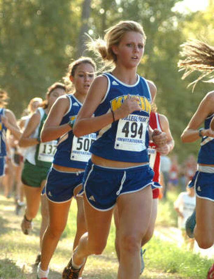 Senior Katelyn Charron, No. 494, and junior Elaina McHenry, No. 505, help make the Klein girls one of the top cross country teams in the Houston area. Photo: David Hopper, For The Chronicle