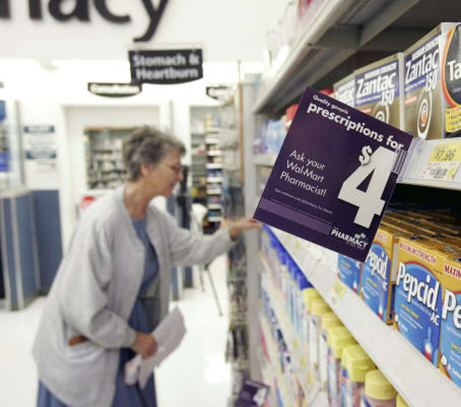 Cyrene Winkler looks through the off-the-shelf products after picking up a prescription at a Wal-Mart on Tomball Parkway. She is interested in saving money with the $4 generic drug program. After a successful test in Florida, Wal-Mart is introducing the plan in 14 additional states, including Texas. Photo: Craig Hartley, For The Chronicle
