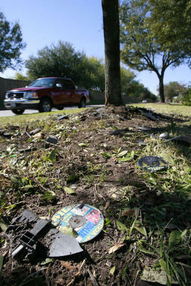 Debris left from the scene of an alleged street racing accident litters a median on West Little York in Houston. The crash, which occurred Sunday night, killed a 15-year-old girl. Photo: James Nielsen, Houston Chronicle