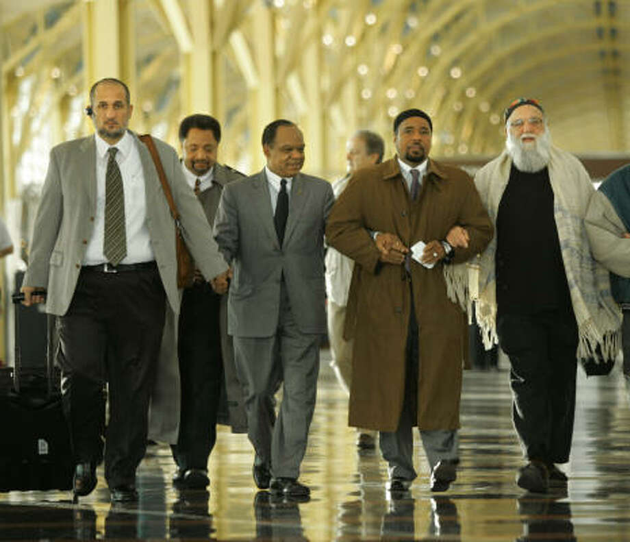 From left, Imam Omar Shahin, Ibrahim Ramey, the Rev. Walter E. Fauntroy, Mahdi Bray and Rabbi Arthur Waskow staged a pray-in at Reagan National Airport in Washington, D.C. Photo: LAWRENCE JACKSON, AP