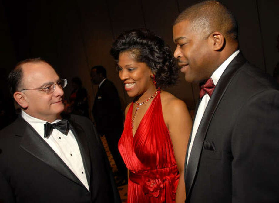 United Negro College Fund gala honorary chair Clarence Cazalot Jr., left, joins chairs Diedra and Terrence Fontaine at the VIP reception before the dinner. Photo: Dave Rossman, For The Chronicle