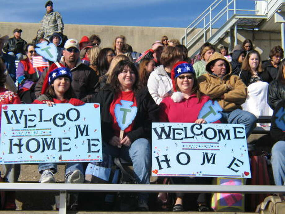 Families of Texas Army National Guard troops wait to be reunited with them at Hood Stadium on Friday. About 500 Guard members from 17 other states worked with the Texas soldiers. Photo: John Gonzales, CHRONICLE